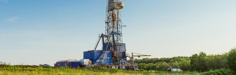 Land,Oil,Drilling,Rig,Blue,Sky